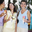 Hispanic women eating ice cream cones — Stock Photo