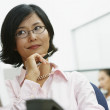 Portrait of Asian businesswoman holding pen — Stock Photo
