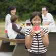 Portrait of Mixed Race girl eating watermelon — Stock Photo