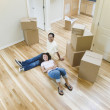 Portrait of Asian couple in new house — Stock Photo