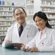 Foto de Stock  : Two pharmacists in pharmacy