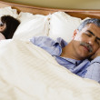 Middle-aged couple sleeping in bed — Stock Photo