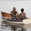 African couple smiling in row boat — Stock Photo #23270712
