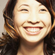 Close up of Asian woman smiling — Stok fotoğraf