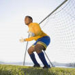 African male soccer player guarding goal — Stock Photo