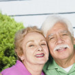 Senior Hispanic couple hugging outdoors — Stock Photo #23270774