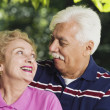 Senior Hispanic couple smiling at each other — Stock Photo