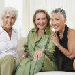 Three senior women sitting on sofa — Stock Photo