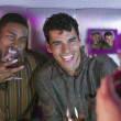 Two men with drinks being video recorded — Stock Photo