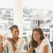 Two women eating in marina restaurant — Stock Photo