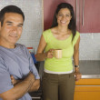 Portrait of Hispanic couple in kitchen — Stock Photo