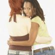 Studio shot of female couple hugging — Stock Photo #23270994