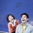 Young man and woman laughing at laptop — Stock Photo #23271030