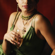 Portrait of Hispanic woman holding cocktail — Stock Photo