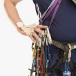 Man wearing rock climbing gear — Foto Stock
