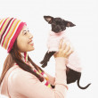 Portrait of Asian woman holding dog — Stock Photo