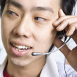 Close up of Asian businessman wearing headset — Stock Photo