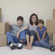 Portrait of mother and children in new house — Stock Photo