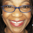 Close up of middle-aged African woman wearing eyeglasses — Foto de Stock