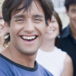 Hispanic man smiling with friends in background — Stock Photo
