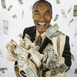 Asian businessman holding bags of money — Stock Photo