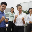 Asian businesspeople cheering in office — Stock Photo