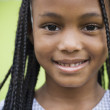 Close up of African girl smiling — Stock Photo #23271640