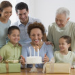 Senior Hispanic woman celebrating birthday with family — Stock Photo