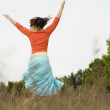 Woman dancing in meadow — Stock Photo