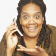 African woman holding cell phone — Stock Photo