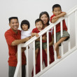 Portrait of Asian family on stairs — Stock Photo