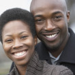 Close up of Africcouple smiling — Foto de stock #23271940
