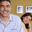 Middle-aged couple smiling in pajamas — Stock Photo