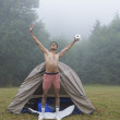 Stock Photo: Indimwearing boxer shorts at campsite