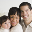 Portrait of Hispanic family with baby — Stock Photo #23272030