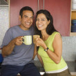 Hispanic couple drinking coffee in kitchen — Stock Photo