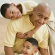 Indian father and sons hugging — Stock Photo #23272200