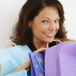 Stock Photo: Hispanic womsmiling with shopping bags