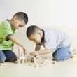 African brothers playing with wooden blocks — Stock Photo #23272276