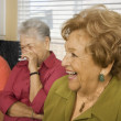 Senior Hispanic women laughing in kitchen — Foto Stock