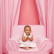 Baby clapping on chair — Stock Photo #23272378
