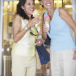Two Hispanic women eating ice cream cones — Stock Photo