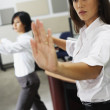 Asian businesswomen practicing tai chi — Stock Photo