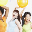 Three women dancing at party — Stock Photo