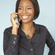 African woman talking on cell phone — Stock Photo