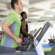 Two men exercising at health club - 图库照片
