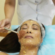 Asian woman receiving facial spa treatment — Stock Photo