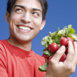 Pacific Islander man holding bunch of radishes — Stock Photo