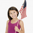 Studio shot of Asian girl holding American flag — Stock Photo