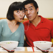 Asian couple eating same noodle — Stock Photo